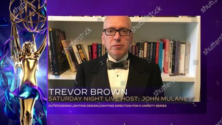 """Trevor Brown accepts the Emmy for Outstanding Lighting Design/Lighting Direction for a Variety Series for """"Saturday Night Live"""" for """"Host: John Mulaney"""" during the 2020 Creative Arts Emmy Awards telecast on at 8:00 PM EDT/5:00 PM PDT on FXX"""