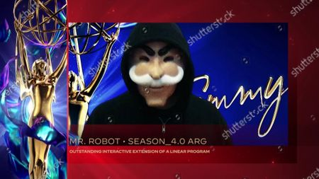 """The revolutionary prophet Mr. Robot accepts the Emmy for Outstanding Interactive Extension Of A Linear Program for """"Mr. Robot"""" for """"Season_4.0 ARG"""" the Emmy for Outstanding Interactive Extension Of A Linear Program for """"Mr. Robot"""" for """"Season_4.0 ARG"""" during the 2020 Creative Arts Emmy Awards telecast on at 8:00 PM EDT/5:00 PM PDT on FXX"""