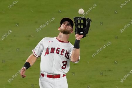 Los Angeles Angels left fielder Taylor Ward catches the ball hit by Texas Rangers Rougned Odor for the out during the eighth inning of a baseball game, in Anaheim, Calif