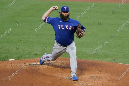 Texas Rangers starting pitcher Lance Lynn throws during the first inning of a baseball game against the Los Angeles Angels, in Anaheim, Calif