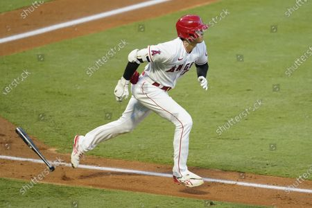 Los Angeles Angels designated hitter Shohei Ohtani runs to first base after hitting a solo home run during the second inning of a baseball game against the Texas Rangers, in Anaheim, Calif