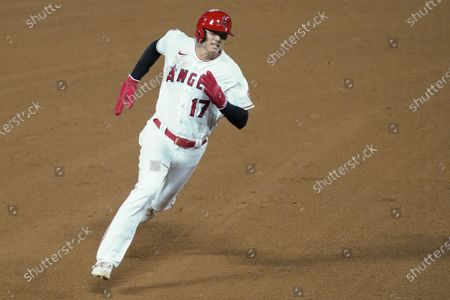 Los Angeles Angels designated hitter Shohei Ohtani runs to third base after a double by Taylor Ward during the fifth inning of a baseball game against the Texas Rangers, in Anaheim, Calif