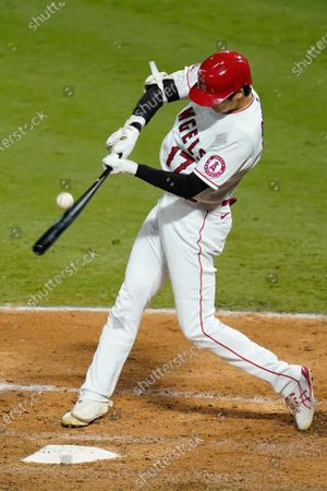 Los Angeles Angels designated hitter Shohei Ohtani hits a foul ball during the fifth inning of a baseball game against the Texas Rangers, in Anaheim, Calif