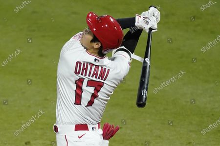 Los Angeles Angels designated hitter Shohei Ohtani swings a strike during the fifth inning of a baseball game against the Texas Rangers, in Anaheim, Calif