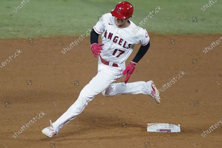Los Angeles Angels designated hitter Shohei Ohtani rounds second base after a double by Taylor Ward during the fifth inning of a baseball game against the Texas Rangers, in Anaheim, Calif