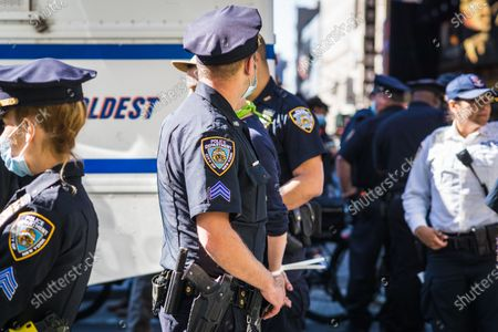 Stock Photo of Anti-Immigration and Customs Enforcement (ICE) protesters standoff with NYC Police in Times Square.