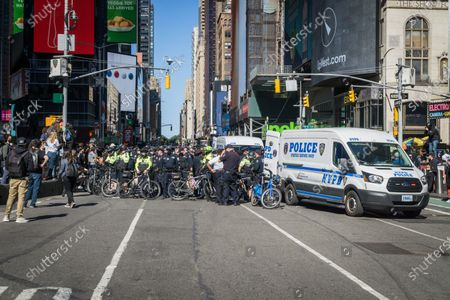 Stock Image of Anti-Immigration and Customs Enforcement (ICE) protesters standoff with NYC Police in Times Square.