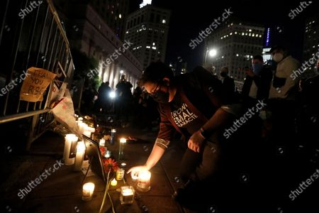 People gather for a candlelight vigil to pay their respects to deceased Supreme Court Justice Ruth Bader Ginsburg in front of the State Supreme Court at 60 Centre Street in New York, New York, USA, 19 September 2020. United States Supreme Court Justice Ruth Bader Ginsburg died on 18 September at the age of 87. Justice Ginsburg, also known as RBG, took office on 10 August 1993 after an appointment by then US President Bill Clinton. She was the oldest of the nine serving supreme court judges at the time of her death.