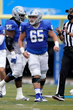 Middle Tennessee offensive lineman Marcus Greer (65) plays against Troy in the first half of an NCAA college football game, in Murfreesboro, Tenn