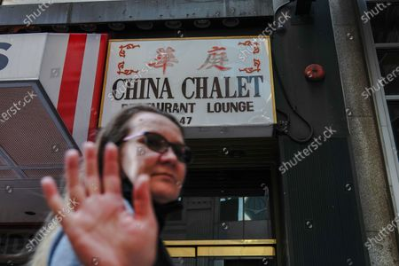 A woman walks past the China Chalet, the Financial District establishment that was a Chinese restaurant by day and party spot by night which has closed permanently.