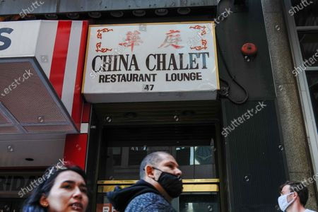 People walk past the China Chalet, the Financial District establishment that was a Chinese restaurant by day and party spot by night which has closed permanently.