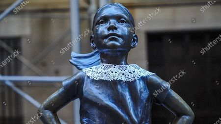 Editorial image of Fearless Girl Gives Tribute to Ruth Bader Ginsburg in New York, US - 19 Sep 2020