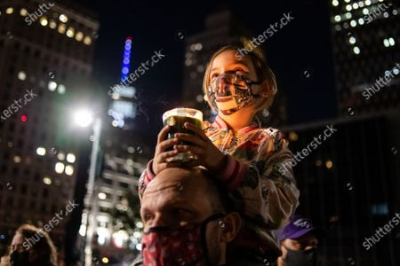 People gather at the New York City Supreme Court building for a vigil held in honor of Ruth Bader Ginsburg on September 20, 2020 in New York, NY. Ruth Bader Ginsburg served as an associate justice on the Supreme Court from 1993 until her death on September 18, 2020.