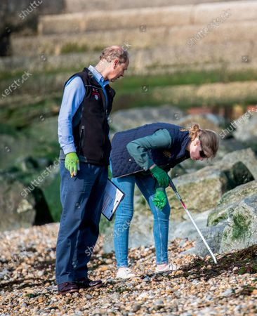 Prince Edward and Lady Louise Windsor collecting rubbish on the beach