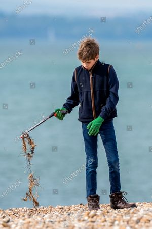 James Viscount Severn collecting rubbish on the beach