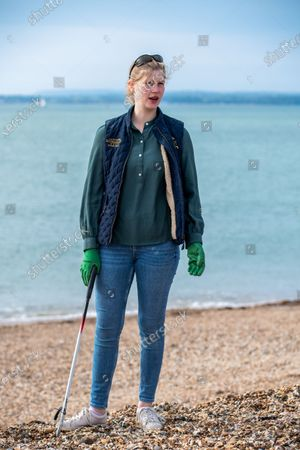 Lady Louise Windsor collecting rubbish on the beach