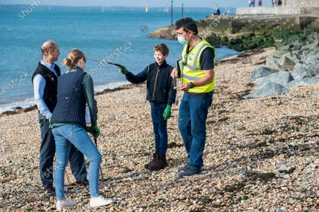 Prince Edward, Lady Louise Windsor and James Viscount Severn collecting rubbish on the beach