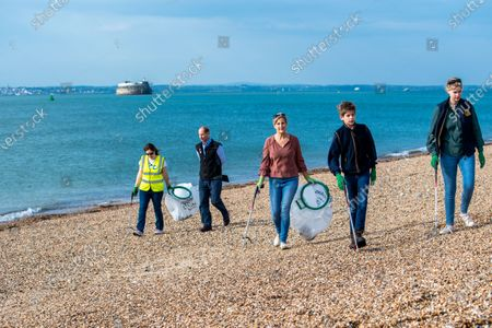 Stock Photo of Prince Edward, Sophie Countess of Wessex and James Viscount Severn collecting rubbish on the beach