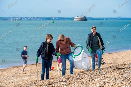 Sophie Countess of Wessex and James Viscount Severn collecting rubbish on the beach