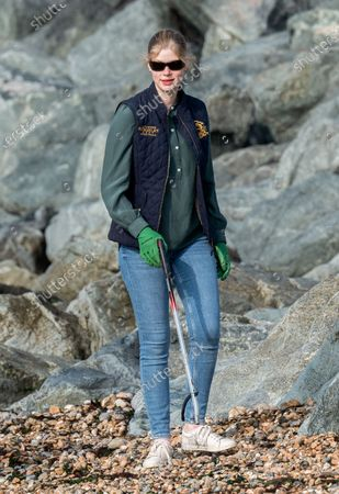 Stock Photo of Lady Louise Windsor collecting rubbish on the beach