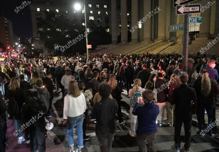 People gather to honor the late Supreme Court Justice Ruth Bader Ginsburg in front of the State Supreme Court House in Lower Manhattan, NYC.