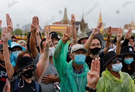 Protesters raises the three-finger salute during the demonstration at the Sanam Luang. Pro-democracy protesters converged at the historic royal heart of Bangkok to demand the resignation of the military-backed government and reforms of the monarchy, long considered a taboo subject in Thailand. The demonstrators gathered first at the Thammasat university campus on a college football field that was the scene of a massacre of left-wing students by pro-regime paramilitaries in 1976.