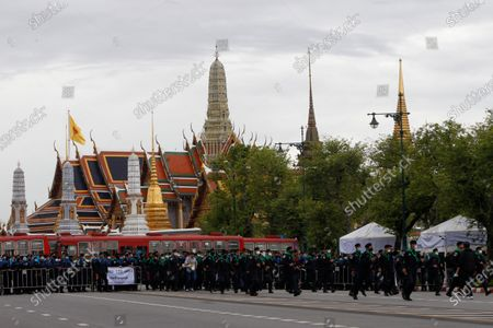 Policemen stand on guard outside the Grand Palace during the demonstration. Pro-democracy protesters converged at the historic royal heart of Bangkok to demand the resignation of the military-backed government and reforms of the monarchy, long considered a taboo subject in Thailand. The demonstrators gathered first at the Thammasat university campus on a college football field that was the scene of a massacre of left-wing students by pro-regime paramilitaries in 1976.