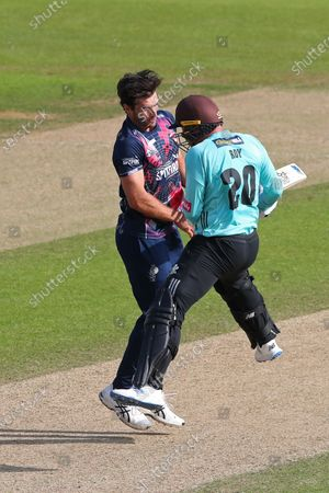 Grant Stewart of Kent and Jason Roy of Surrey get in a tangle