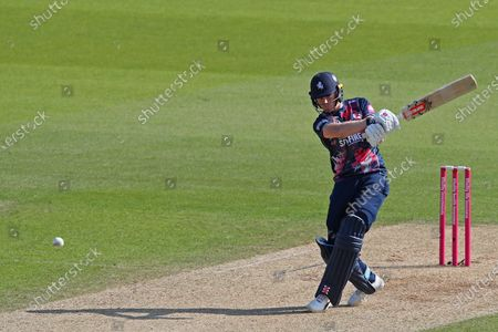 Sam Billings of Kent hits the ball for four runs