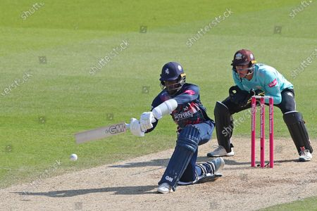 Daniel Bell-Drummond of Kent batting as wicketkeeper Jamie Smith of Surrey looks on