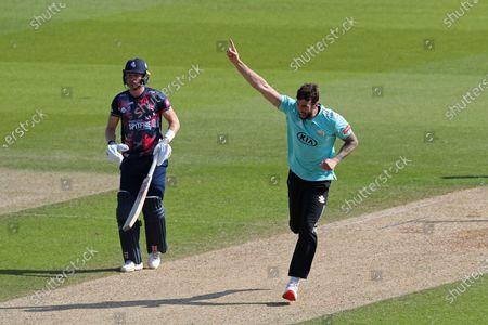Reece Topley of Surrey celebrates taking the wicket of Joe Denly of Kent