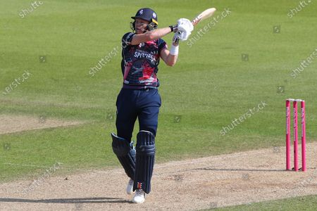 Stock Image of Sam Billings of Kent plays a shot and is caught out by Rikki Clarke of Surrey