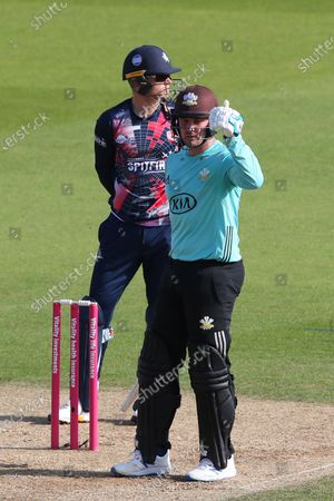 Jason Roy of Surrey gives a thumbs up as he scores a half century