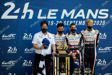 Team chairman Akio Toyoda, drivers Kazuki Nakajima of Japan, Sebastien Buemi of Switzerland and Britain's Brendon Hartley of the Toyota Gazoo Racing Team attends during the anthem ceremony of the 88th 24-hour Le Mans endurance race, in Le Mans, western France, . Due to coronavirus crisis, the race takes place without spectators