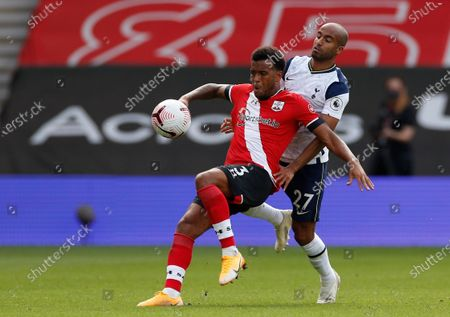 Southampton's Ryan Bertrand, front, duels for the ball with Tottenham's Lucas Moura during the English Premier League soccer match between Southampton and Tottenham Hotspur at St. Mary's Stadium in Southampton, England