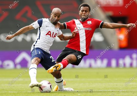 Ryan Bertrand (R) of Southampton in action against Lucas Moura (L) of Tottenham during the English Premier League match between Southampton and Tottenham Hotspur in Southampton, Britain, 20 September 2020.