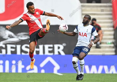 Tottenham Hotspur's Tanguy Ndombele (R) in action against Southampton's Ryan Bertrand (L) during the English Premier League match between Southampton and Tottenham Hotspur in Southampton, Britain, 20 September 2020.