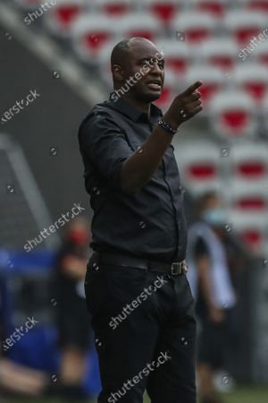 Nice's head coach Patrick Vieira gives instructions to players during the French League One soccer match between Nice and Paris Saint-Germain at the Allianz Riviera stadium in Nice, France