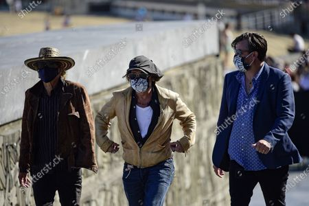 """Actor and film producer Johnny Deep, center, arrives for a photocall with Julien Temple and Stephen Deuters, right, to promote their film """"Crock of Gold: A Few Rounds with Shane Macgoman"""" during the 68th San Sebastian Film Festival, in San Sebastian, northern Spain"""