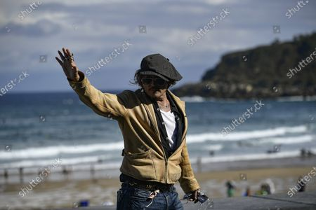 """Actor and film producer Johnny Deep, waves fans during the photocall to promotes his film """"Crock of Gold: A Few Rounds with Shane Macgoman"""" at the 68th San Sebastian Film Festival, in San Sebastian, northern Spain"""