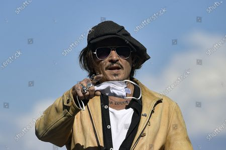 """Actor and film producer Johnny Deep, gestures during the photocall to promotes his film """"Crock of Gold: A Few Rounds with Shane Macgoman"""" at the 68th San Sebastian Film Festival, in San Sebastian, northern Spain"""