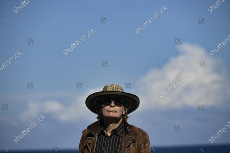 """British producer Julien Temple poses during the photocall to promote his film """"Crock of Gold: A Few Rounds with Shane Macgoman"""" at the 68th San Sebastian Film Festival, in San Sebastian, northern Spain"""