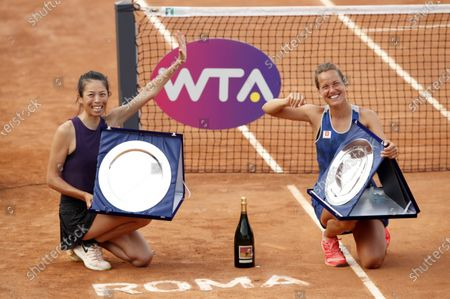 Su-Wei Hsieh of Taipei (L) and Barbora Strycova of the Czech Republic celebrate with their trophies after winning the Women's doubles final match at the Italian Open tennis tournament in Rome, Italy, 20 September 2020.