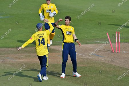 Stock Photo of Wicket, hat trick, four wickets in four balls - Shaheen Afridi of Hampshire high fives with James Vince after bowling Steven Finn of Middlesex during the Vitality T20 Blast South Group match between Hampshire County Cricket Club and Middlesex County Cricket Club at the Ageas Bowl, Southampton