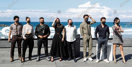 Alejandro Sanz (3rd-L), film director Carlos Sedes (4th-R), and cast members Spanish actors Blanca Suarez (4th-L), Javier Rey (3rd-R), Pablo Molinero (L), Maria Pedraza (2nd-L), Carlos Cuevas (2nd-R) and Guiomar Puerta (R) pose for the photographers prior to the presentation of the film 'El verano que vivimos' during 68th San Sebastian International Film Festival (SSIFF) at La Concha beach promenade in San Sebastian city, Basque country, northern Spain, 20 September 2020. The film festival will run from 18 to 26 September 2020 under safety measures like obligatory face mask use and red carpets without public due to the Covid-19 coronavirus pandemic. Organizers have also reduced the number of film screenings as well as the seating capacity in cinemas.