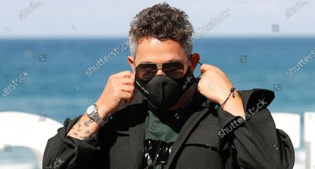 Alejandro Sanz poses for the photographers prior to the presentation of the film 'El verano que vivimos' during 68th San Sebastian International Film Festival (SSIFF) at La Concha beach promenade in San Sebastian city, Basque country, northern Spain, 20 September 2020. The film festival will run from 18 to 26 September 2020 under safety measures like obligatory face mask use and red carpets without public due to the Covid-19 coronavirus pandemic. Organizers have also reduced the number of film screenings as well as the seating capacity in cinemas.
