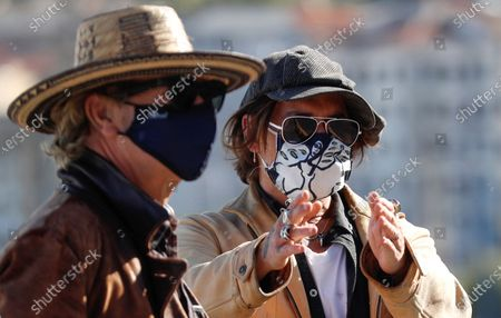Johnny Depp (R) and British film director Julien Temple wear face masks during a photocall for 'Crock of Gold: A Few Rounds with Shane McGowan' at the 68th annual San Sebastian International Film Festival (SSIFF), in San Sebastian, Spain, 20 September 2020. The film festival runs from 18 to 26 September 2020 under safety measures like obligatory face mask use and red carpets without public due to the Covid-19 coronavirus pandemic. Organizers have also reduced the number of film screenings as well as the seating capacity in cinemas.