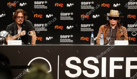 Johnny Depp (L) and British film director Julien Temple (R) attend a press conference on 'Crock of Gold: A Few Rounds with Shane McGowan' at the 68th annual San Sebastian International Film Festival (SSIFF), in San Sebastian, Spain, 20 September 2020. The film festival runs from 18 to 26 September 2020 under safety measures like obligatory face mask use and red carpets without public due to the Covid-19 coronavirus pandemic. Organizers have also reduced the number of film screenings as well as the seating capacity in cinemas.