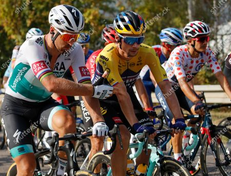 Stock Picture of Slovakia's Peter Sagan, left, and Slovenia's Primoz Roglic, center, talk during the twenty-first and last stage of the Tour de France cycling race over 122 kilometers (75.8 miles), from Mantes-La-Jolie to Paris, France