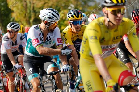 Stock Image of Slovakia's Peter Sagan, left, and Slovenia's Primoz Roglic, center, talk as they ride behind Slovenia's Tadej Pogacar, wearing the overall leader's yellow jersey, during the twenty-first and last stage of the Tour de France cycling race over 122 kilometers (75.8 miles), from Mantes-La-Jolie to Paris, France